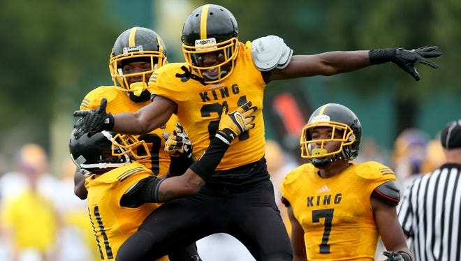 Detroit Martin Luther King's Lavert Hill celebrates his game-saving interception in front of Warren De La Salle's Myles Charlie during the Prep Kickoff Classic on Aug. 29, 2015 at Wayne State's Tom Adams Field in Detroit.
