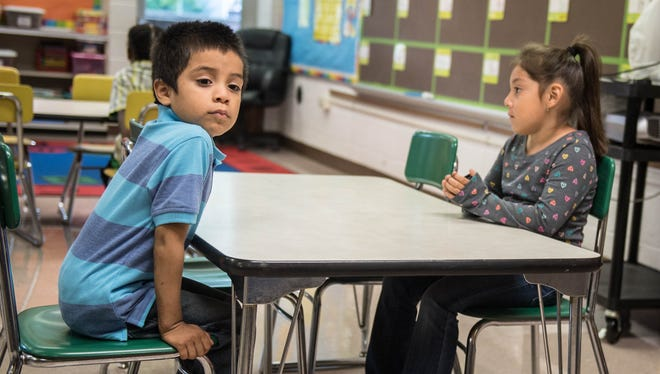 Leland Nunez sits in his kindergarten class on the first day of school Tuesday with his cousin, Ana Julia.