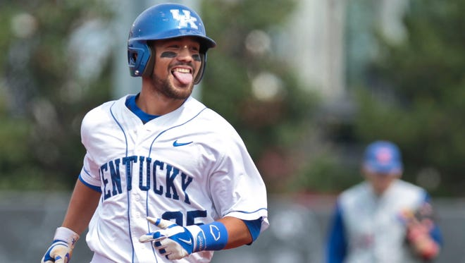 Kentucky's Ka'ai Tom celebrates as he rounds the bases after his home run brought two runners and himself to tie Kansas 3-3 in the bottom of the first. May 30, 2014
