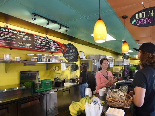 Owner Lisa Carlotta gets orders from Kevin Samsal, Miranda Garliss and Gianni Carlotta at the Juice Shack located at 1607 Philadelphia Avenue in downtown Ocean City, which serves healthy juices & smoothies.