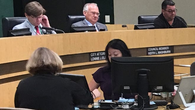 Simi Valley Councilman Mike Judge, right, has apologized for posting to Facebook from the dais during the council's June 25 meeting at which the council reaffirmed its opposition to California's sanctuary state law.