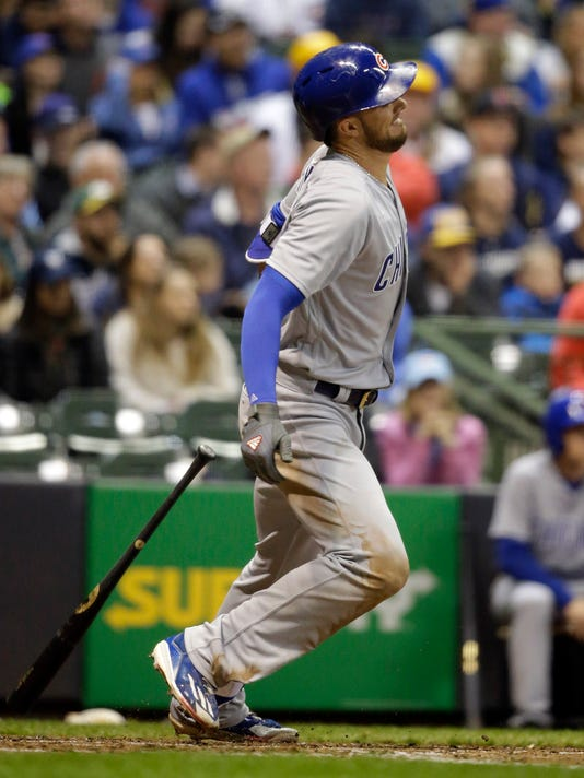 Chicago Cubs' Kris Bryant hits an infield single against the Milwaukee Brewers during the fifth inning of a baseball game Friday, April 7, 2017, in Milwaukee. (AP Photo/Jeffrey Phelps)