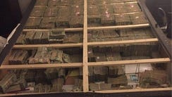 Feds seized millions stuffed in the box spring of this
