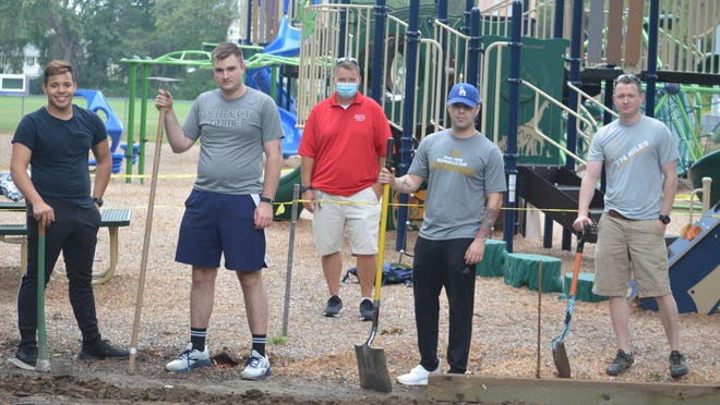 From left, USS Virginia crew members Manuel Benabe, Jake Rogan, Silberio Quintero and Ross Wilson volunteer with some landscaping at Kids Kingdom in Hampton Thursday morning. Hampton Parks and Recreation Director Rene Boudreau is in back.