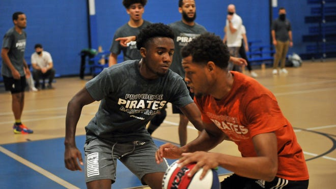 Will Leviton, left, a former walk-on-turned-scholarship player at the University of Rhode Island, was at Saturday's tryout for the Providence Pirates, a  new ABA team.