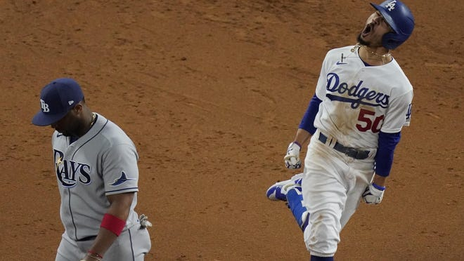 Los Angeles Dodgers' Mookie Betts celebrates after a home run against the Tampa Bay Rays during the eighth inning in Game 6 of the World Series on Tuesday, Oct. 27, 2020, in Arlington, Texas. The Dodgers won the game and the Series.