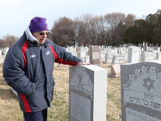 Art Stoler of Spencerport after seeing the news about vandalism at Waad Hakolel Cemetery, also known as Stone Road Cemetery, checked on his grandparents' graves.  Their graves were unharmed.