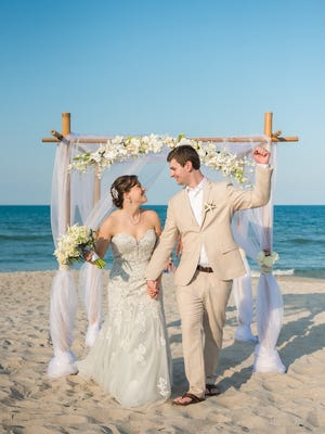 Andrea and Andrew Kom, Melbourne, had their wedding at Paradise Beach in Indialantic.