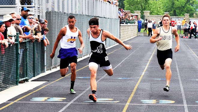 New Lexington's Kameron Bowen races to a first-place finish in the finals of the 100 meters during the Division II regional track meet on Saturday at Athens High School. Bowen became the first Panther in 15 years to reach the state meet.