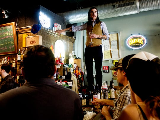 George Talley, of Suttree's, welcomes patrons during a beer bottle share at Suttree's in Knoxville, Tennessee on Saturday, March 25, 2017. A crowd of around 100 people shared beers from throughout the world including craft beers and speciality beers.