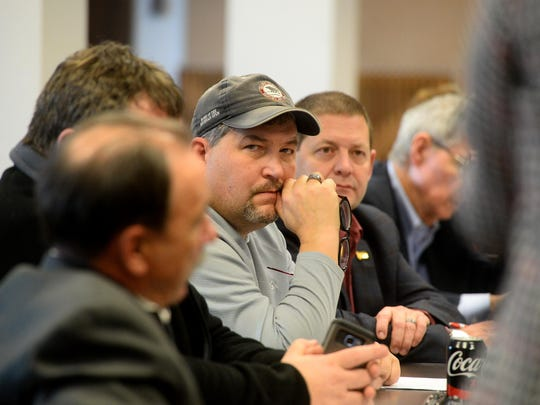 Rep. Rob Cook, R-Conrad, and other area legislators listen to a presentation while meeting with Great Falls and Cascade County officials on Thursday.