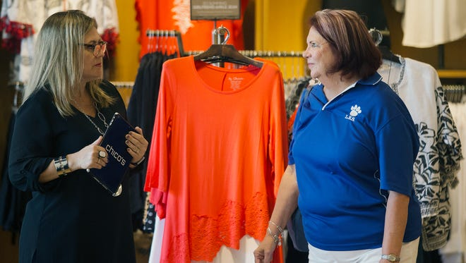 """""""I buy online, but I absolutely love coming to Chico's. The customer service is really great,"""" says Diane Elswick, right, while shopping Thursday at Chico's at the Bell Tower Shops in south Fort Myers."""