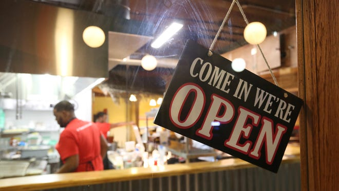 The open sign at the Rochester Youth Culinary Experience at the Village Gate in Rochester.