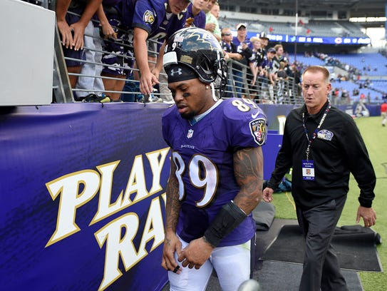 Baltimore wide receiver Steve Smith walks off the field