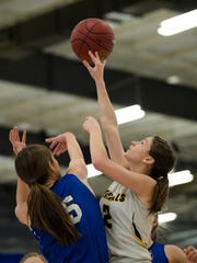 Wilcox Academy's Laken Harvell (15) blocks a shot by