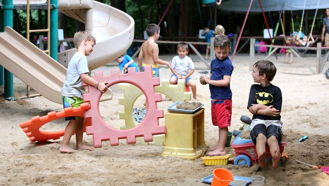 Campers play in the sand at Acres of Adventure Camp at Ann and Andy Child Care in Elmsford, Aug. 25, 2015.