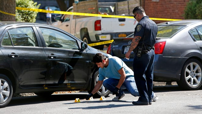 Police investigate the scene where a pedestrian was struck by a vehicle on Cooper Avenue in New Rochelle, Sept. 7, 2015.