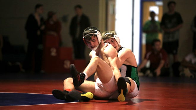 Justin Payne, left, is 18-0 this season for the Erwin wrestling team.