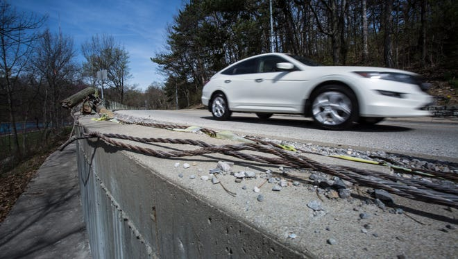 Wed., March 30, 2016: Sections of the cable barriers on Eden Park Drive are down, exposing cars to a steep drop.