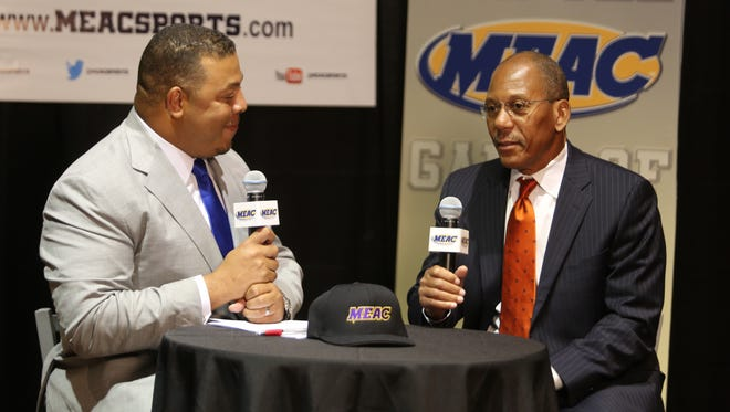 FAMU football coach Alex Wood (right) speaks with ESPN analyst Jay Walker at the MEAC's annual media luncheon.