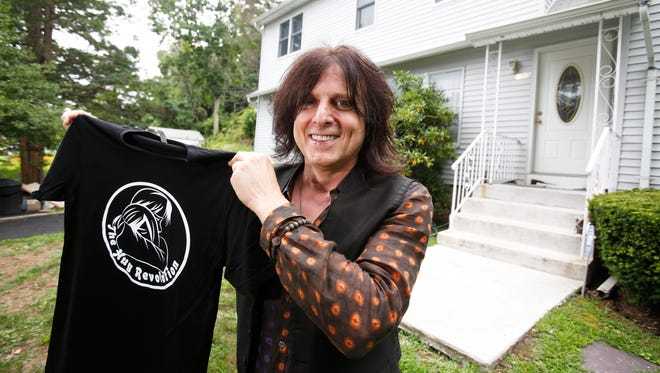 Rick Agosta of the music band the Burbans,  in front of the former home of Steven Tyler of Aerosmith in Yonkers  on Aug. 25, 2016.  Acosta's father was the former manager for Steven Tyler and Agosta is now holding a concert linking his charity The Hug Revolution to Steven Tyler's charity Janie's Fund,