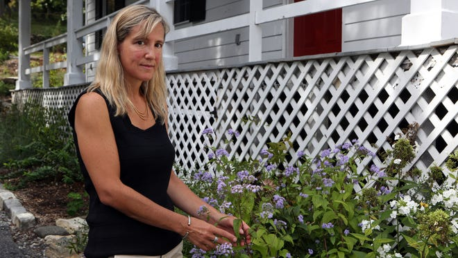 """Cornell Cooperative Extension Master Gardener Melissa Fabel, who said she was """"fired"""" for writing a letter to the board about her concerns. She's pictured here at her home in Chappaqua."""