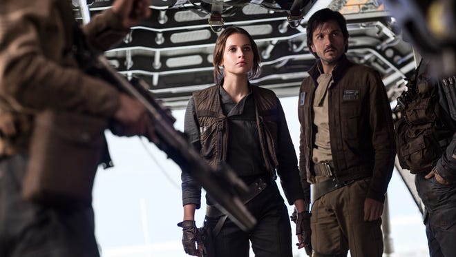 "Felicity Jones and Diego Luna (right) take on a key mission for the rebellion in ""Rogue One: A Star Wars Story."""