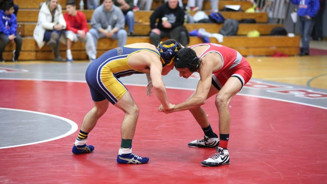 Wrestlers battle it out in the finals of the Cutters Classic Tournament held at Fair Lawn High School on Saturday, Dec. 17, 2016