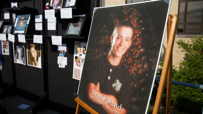 A portrait of Ryan Poland, 24, who died on November 18, 2013, was one of the many in the tribute area for the 5th Annual NKY Hates Heroin 5K. Nearly 1,000 people came out to honor and remember those who have died from addiction and celebrate ones in recovery. The event at Simon Kenton High School in Independence raises money and awareness for an epidemic that saw 1,404 overdose deaths in Kentucky in 2016.