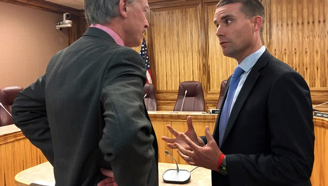 Colorado Gov. John Hickenlooper, left, speaks with California state Sen. Mike McGuire, D-Healdsburg, on Tuesday in Sacramento. Hickenlooper spoke to a committee of California lawmakers about the challenges his state has faced regulating legal marijuana.