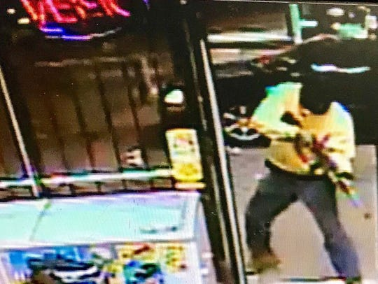 This surveillance image shows the suspect in shooting death of Terry Lee Gunn in a Jackson gas station.