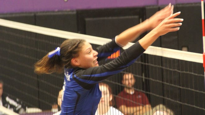 Millbrook's Megan Fergus goes for a block against Pawling in the volleyball Class C regional final.