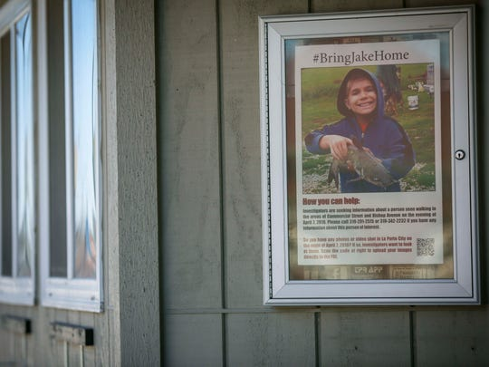 Missing teen Jake Wilson picture is in the window of La Porte City's newspaper, The Progress Review, Thursday, April 19, 2018. Residents, friends and high schoolers handed out flyers to help in the search for the autistic teenager who has been missing for almost two weeks.