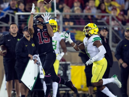 Stanford's JJ Arcega-Whiteside (19) catches a deep pass ahead of Oregon's Thomas Graham Jr. (4) during the first quarter of an NCAA college football game, Saturday, Oct. 14, 2017, in Stanford, Calif. (AP Photo/D. Ross Cameron)