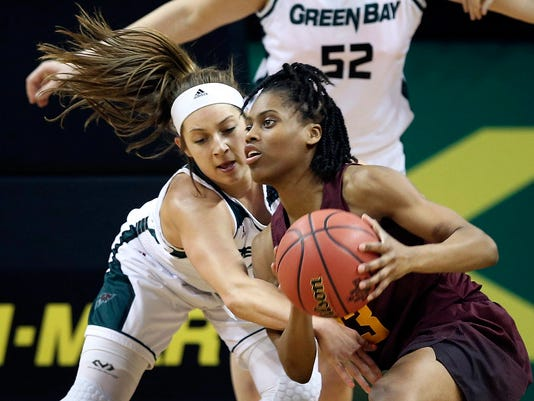 Green Bay's Laken James, left, battles Minnesota's Kenisha Bell for a loose ball during first quarter of a first-round game at the NCAA women's college basketball tournament in Eugene, Ore., Friday, March 16, 2018. (AP Photo/Chris Pietsch)