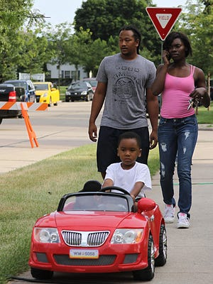 Oshkosh promotes safety in the community as more than a dozen locations took part in the National Night Out in 2014. On the 1900 block of Evans Street, Jaden Jackson lead the way to the gathering.
