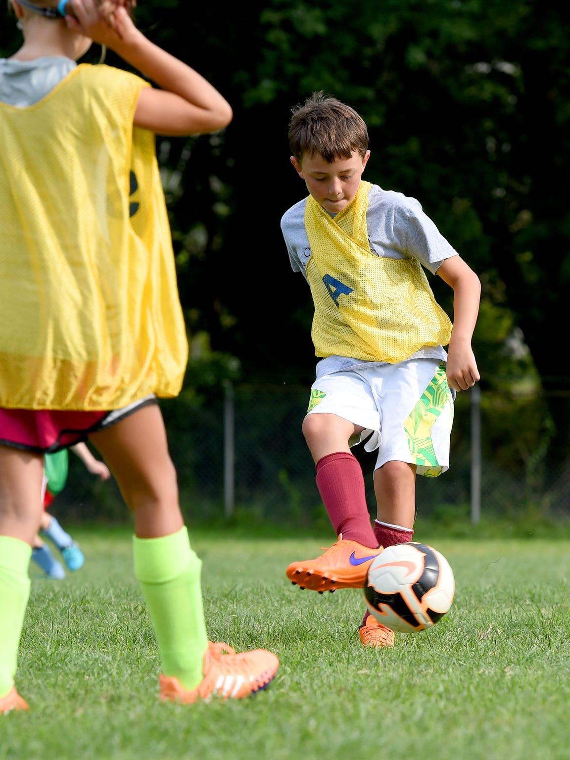 Alex Barrett of the U12 boys program kicks the ball