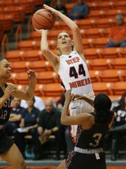 UTEP's Katrina Zec, top, shoots over Texas Southern's Joyce Kennerson, right, and Chynna Ewing in November. Zec was called for charging on the play.