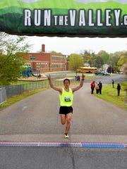 Joel Hess of Harrisonburg lis first to cross the finish