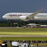 A Qatar Airways Boeing 787 Dreamliner lands during an aerial display on the third day of the Farnborough International Airshow in England on July 11, 2012.