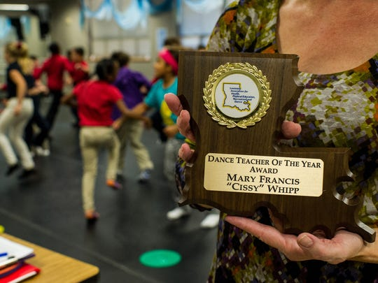 """Mary Francis """"Cissy"""" Whipp holds her award for """"Dance Teacher of the Year"""" from the Louisiana Association for Health, Physical Education, Recreation, and Dance at J. Wallace James Elementary School in Lafayette, La., Thursday, Nov. 19, 2015."""