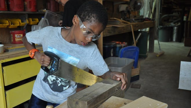 Kids at Camp Spring Creek focus not only on dyslexia. Wood shop is one of many activities available to campers.