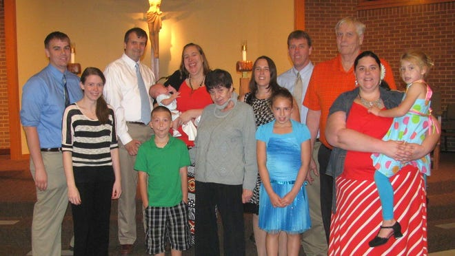 This is the last photo taken of the entire Rottier family together at a baptism at St. Bernard Parish in Green Bay in September 2013 before Jean Rottier died of ALS seven months later. Pictured are, in front from left, Karissa Rottier, Garrett Rottier, Jean Rottier, Giselle Rottier, Stephanie Rottier and Gretchen Rottier; and in back from left, Mitchell Rottier, William Soderdahl, Ari Soderdahl, Rachel Soderdahl, Tracie Van Gheem-Rottier, Dustin Rottier and Bob Rottier.