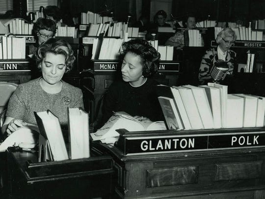 Willie Stevenson Glanton, center, talks to a clerk about a case in this 1965 photo. Glanton was the first female assistant Polk County attorney and the first black female legislator in Iowa.