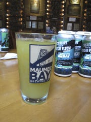 """A glass of """"Alegae Bloom"""" beer at Maumee Bay Brewing Co. in Toledo, Ohio."""