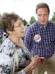 Kraig Bruder gets a laugh from Naomi Gross of Carroll Township outside the polls at the township municipal building Tuesday, April 26, 2016. Bruder is a candidate in the race for the 92nd House District. Bill Kalina photo