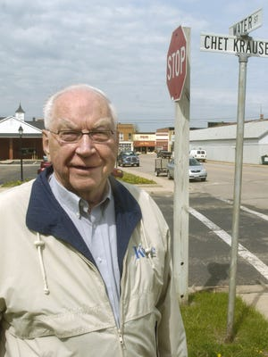Chet Krause stands alongside the street named in his honor by the village of Iola honoring his impact on the community in this 2008 photo. Krause, the founder of Krause Publications and the Iola Car Show, died on Saturday, June 25, 2016 at the age of 92.