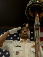 Vietnam Veterans of America Honor Guard John Ross salutes
