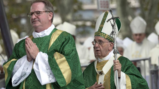 Pope Francis arrives for a Mass on the Benjamin Franklin Parkway, Sunday.