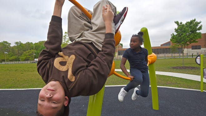 At Pyne Poynt Park in Camden, Camp Joy participant Matthew Rodriguez plays on May 2.